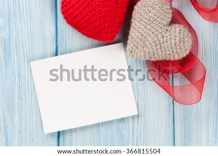 Valentines day greeting card or photo frame and handmaded hearts over blue wooden table. Top view with copy space - stock photo