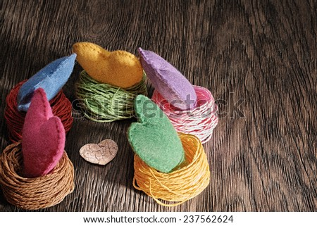 Valentines Day. Handmade Hearts in nests. Love concept, Film grain. Retro on wooden background - stock photo