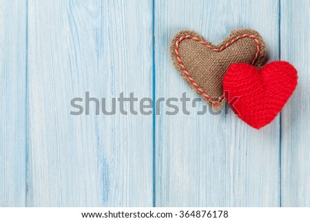 Valentines day handmaded hearts over wooden background. Top view with copy space - stock photo