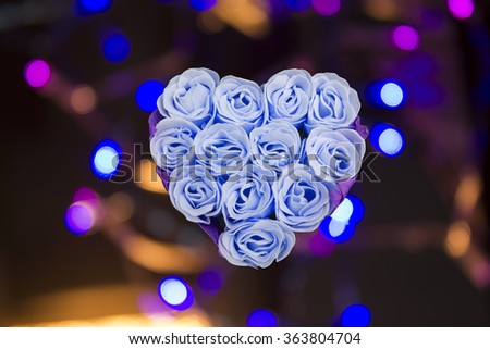 "red_rose_with_blue_bokeh_hearts_background"" stock images, royalty, Ideas"