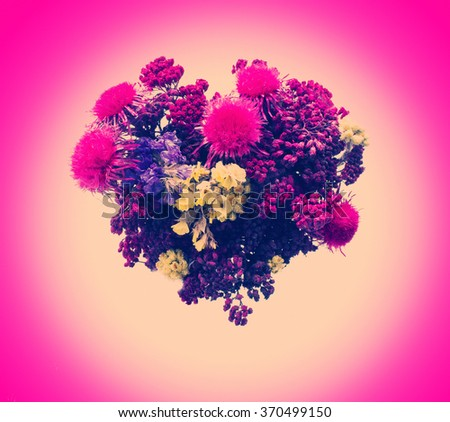 Valentines Day Heart Made of Red Flowers Isolated on Pink Background. - stock photo
