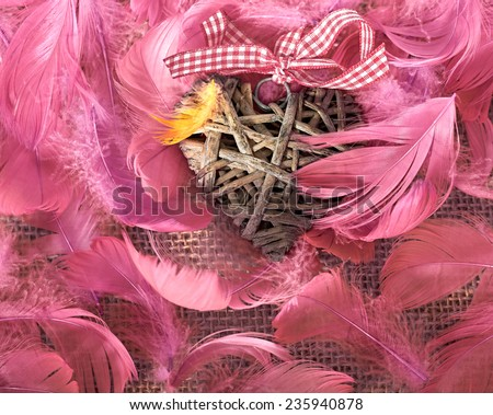 Valentines Day. Heart made of vine in pink  feathers. Love concept. Retro - stock photo