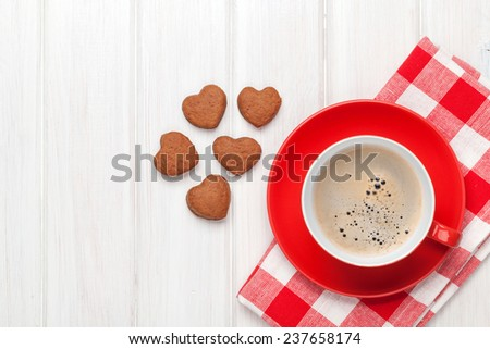 Valentines day heart shaped cookies and red coffee cup. View from above with copy space - stock photo