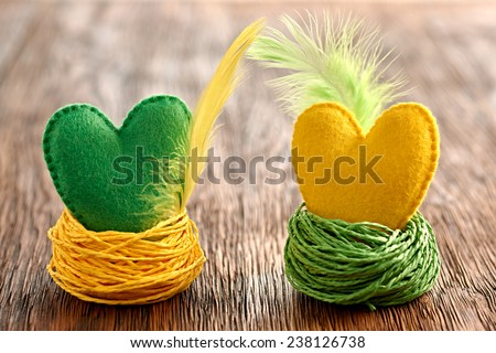 Valentines Day. Hearts Handmade Couple with feathers in Nests. Love concept on wood - stock photo
