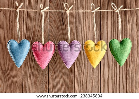 Valentines Day. Hearts Handmade set, hanging on rope. Love concept on wooden background. Retro - stock photo