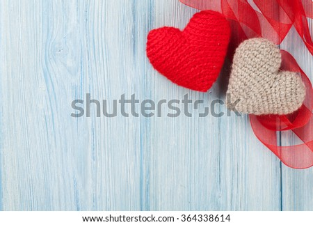 Valentines day hearts over blue wooden background. Top view with copy space