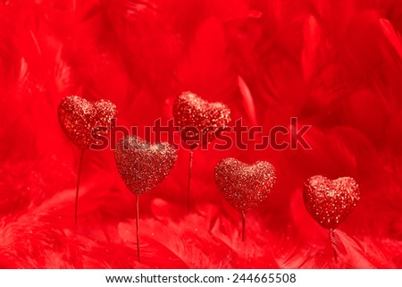 Valentines Day. Hearts red sparkling on  beautiful red feathers background. Love concept - stock photo