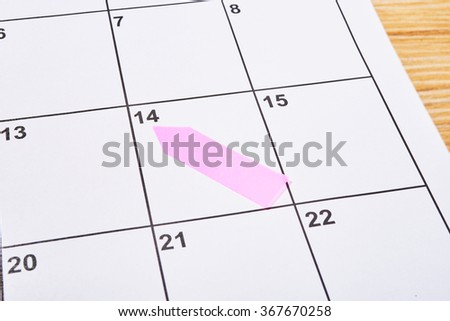 Valentines day in agenda with pink sticky - stock photo