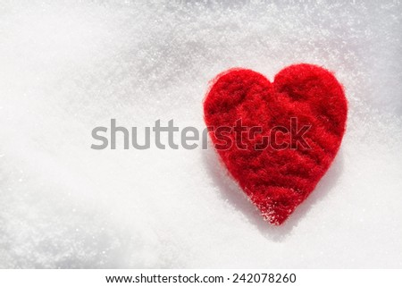 Valentines Day love heart in winter in the snow from above