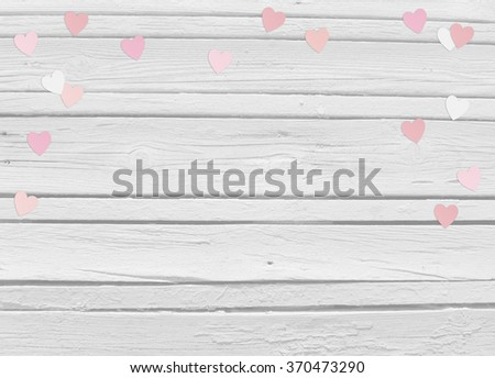 Valentines day or wedding mock up scene with paper hearts confetti and old white wooden background, empty space for your text, top view - stock photo