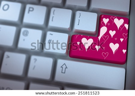 Valentines day pattern against pink enter key on keyboard