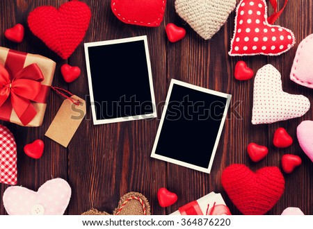 Valentines day photo frames and handmaded hearts over wooden table. Top view with copy space. Retro toned - stock photo