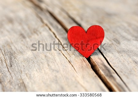 Valentines day red heart on old wood. Holidays card with copy space.