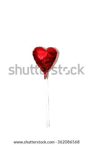 Valentines Day Red Heart Shaped Mylar Helium Balloons with White String and shadows. Isolated on white with room for your text. Valentines day is enjoyed by lovers around the world on February 14. - stock photo