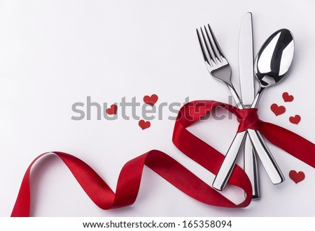 Valentines day set with silverware - stock photo