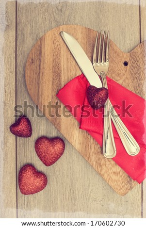 Valentines Day table setting with red heart decoration - stock photo