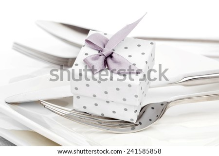 Valentines day table setting with romantic gift box,  to celebrate the holiday with a loved one - stock photo