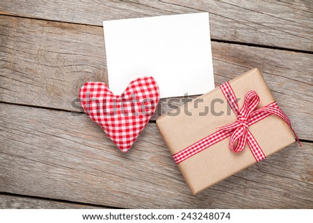 Valentines day toy heart, blank greeting card and gift box over wooden table background - stock photo