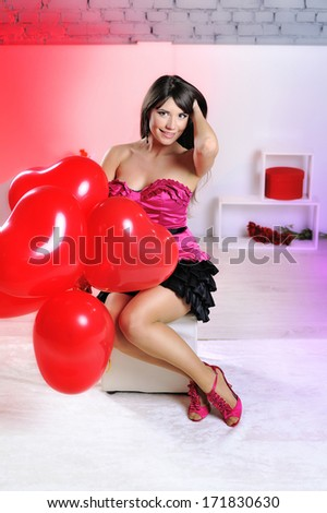 Valentines day woman holding red heart balloon  - stock photo