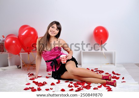 Valentines day woman holding red heart balloon. - stock photo