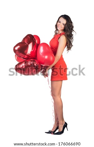 Valentines day. Woman smiling holding red heart shaped balloon. - stock photo
