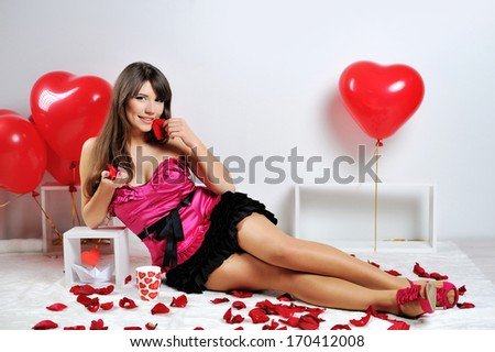 Valentines day woman with red heart balloon and cup  - stock photo