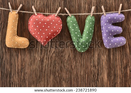Valentines Day. Word Love dots, Heart Handmade, hanging on rope. Vintage style. Retro. Love concept on wooden background - stock photo