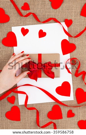 Valentines Gift On Canvas Background With a White Card.