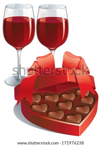Valentines gift. Two wineglasses with Red wine  and heart shaped box of chocolates candy isolated on white background - stock photo