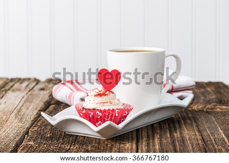 Valentines inspired red velvet cupcake served with coffee. - stock photo