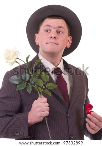 Valentines Man with flower and gift isolated on white background. Proposal scene - stock photo