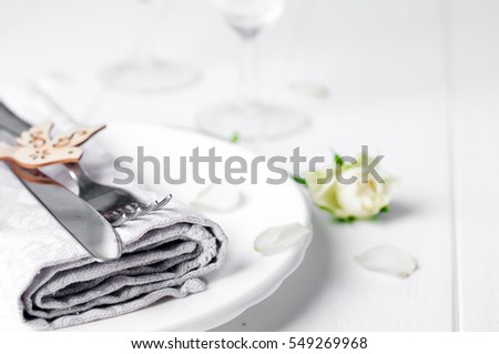 Valentines table setting with white roses plates and cutlery