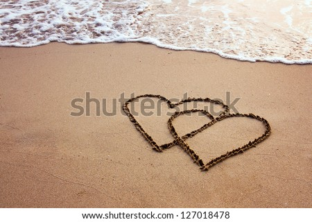 valentines, two hearts on the beach - stock photo