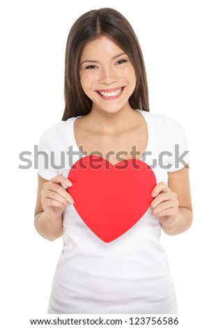 Valentines woman holding heart smiling happy. Love concept with happy multiracial Asian / Caucasian female model isolated on white background.