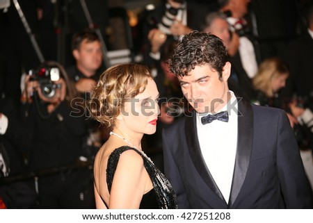 Valeria Golino, Riccardo Scamarcio attend the 'It's Only The End Of The World (Juste La Fin Du Monde)' Premiere during the 69th annual Cannes Festival at the Palais on May 19, 2016 in Cannes, France.  - stock photo