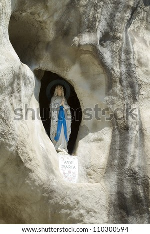 VALKENBURG - AUGUST 10: The well-known tourist spot of Valkenburg in the Netherlands is home to a replica of the Lourdes Cave, including the statue of the Virgin Mary, on August 10, 2012. - stock photo