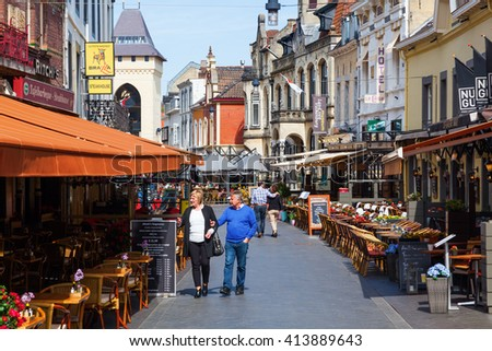 Valkenburg, Netherlands - April 11, 2016: city view with restaurants and unidentified people in the old town of Valkenburg. Valkenburg aan de Geul in province Limburg is a popular tourist destination