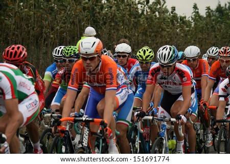 VALKENBURG, NETHERLANDS - SEPTEMBER 29 : Cyclists peleton  during the cycling world championship september 29,2012 in Valkenburg, The Netherlands - stock photo