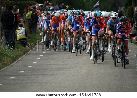 VALKENBURG, NETHERLANDS - SEPTEMBER 29 : Mark cavendish in front of the peleton during the cycling world championship september 29,2012 in Valkenburg, The Netherlands. - stock photo