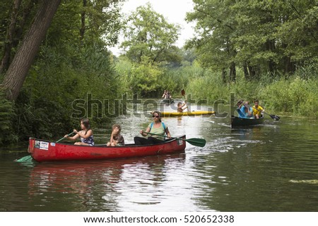 "VALKENSWAARD, NETHERLANDS - 2015, JULY 27, 2015: Canoeing on river the ""Dommel"""