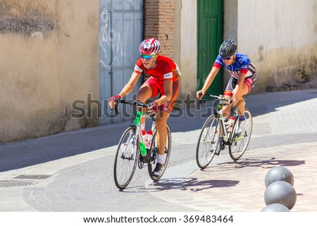 VALLADOLID, Spain August 26, 2015: young cyclists participating in a race through the towns of Valladolid in Valladolid, Spain - stock photo