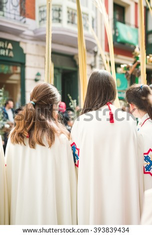 VALLADOLID, SPAIN - MARCH 20, 2016 - People in The Hosanna Procession during Palm Sunday in Holy Week in Valladolid, Spain, March 20, 2016.