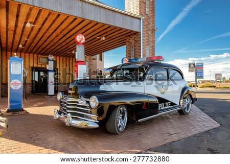 Valle, AZ - CIRCA MARCH 2015 - Excellent Police retro car on a gas station in Valle, Arizona, circa March 2015 - stock photo