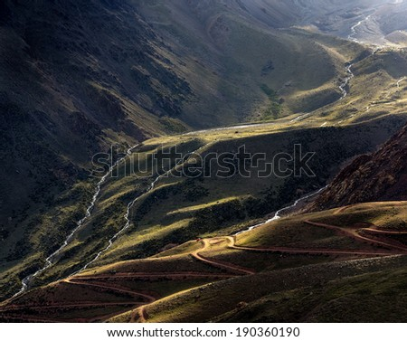 Vallecitos provincial park, Mendoza, Argentina. Valley  backlight with path and river at the entrance to Cordon del Plata - stock photo