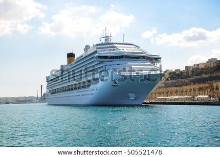 VALLETTA, MALTA - APRIL 22: The Costa Fascinosa cruise ship with tourists is in harbour on April 22, 2015 in Valletta, Malta. More then 1,6 mln tourists is expected to visit Malta in year 2015.
