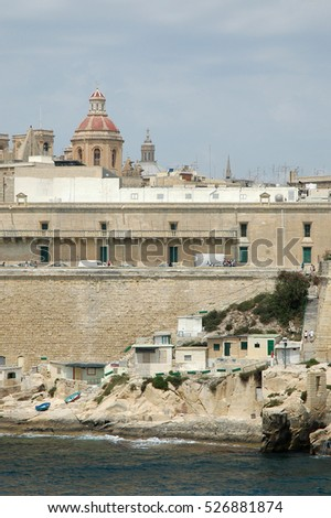 VALLETTA, MALTA - JUNE 17, 2005: View of the coast and shacks of fishermen, by the sea