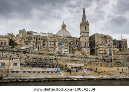 VALLETTA, MALTA - MARCH 21: View of the maltese capital from boat tour of Grand Harbour  on March 21 in Valletta, Malta.