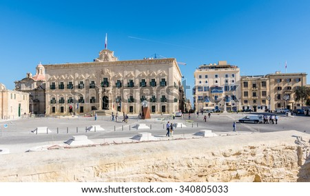 VALLETTA, MALTA - NOVEMBER 12,2015 : Auberge de Castille and city streets in Valletta, Malta on November 12, 2015.