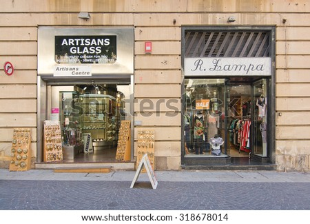 VALLETTA, MALTA - SEPTEMBER 15, 2015: Artisans glass shopping in the streets of Valletta on a sunny day in September 15, 2015 in Valletta, Malta.