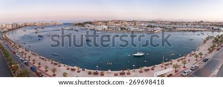 Valletta seafront skyline view across Marsamxett from Sliema, Malta. Panorama sunset view of Marsamxett harbor. - stock photo